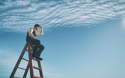 Success business and ambitions concept. Businessman climbed on top of the stairs looking up to horizon. Success business and ambitions concept.  This is a 3d Stock Photos