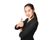 Success business Asian woman in black suit. Success business Asian woman with thumb up in isolated white background Royalty Free Stock Photo