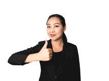Success business Asian woman in black suit. Success business Asian woman with thumb up in isolated white background Royalty Free Stock Photos