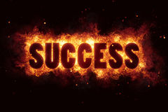 Success business career text on fire flames explosion burning Royalty Free Stock Image