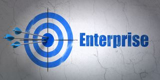 Business concept: target and Enterprise on wall background. Success business concept: arrows hitting the center of target, Blue Enterprise on wall background, 3D Royalty Free Stock Photo
