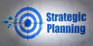 Business concept: target and Strategic Planning on wall background royalty free stock photography