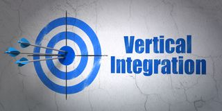 Business concept: target and Vertical Integration on wall background Royalty Free Stock Photos