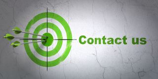 Business concept: target and Contact us on wall background. Success business concept: arrows hitting the center of target, Green Contact us on wall background Royalty Free Stock Images