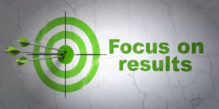Business concept: target and Focus on RESULTS on wall background. Success business concept: arrows hitting the center of target, Green Focus on RESULTS on wall Stock Photo