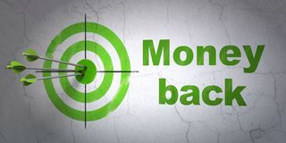 Business concept: target and Money Back on wall background. Success business concept: arrows hitting the center of target, Green Money Back on wall background Royalty Free Stock Images