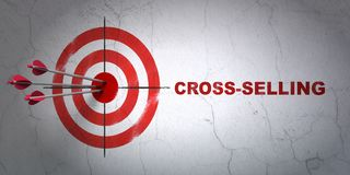 Business concept: target and Cross-Selling on wall background. Success business concept: arrows hitting the center of target, Red Cross-Selling on wall Stock Photos