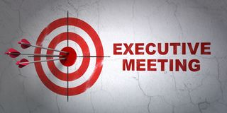 Business concept: target and Executive Meeting on wall background. Success business concept: arrows hitting the center of target, Red Executive Meeting on wall Royalty Free Stock Photo