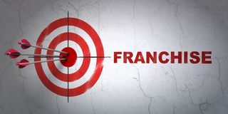 Business concept: target and Franchise on wall background. Success business concept: arrows hitting the center of target, Red Franchise on wall background, 3D Royalty Free Stock Photo