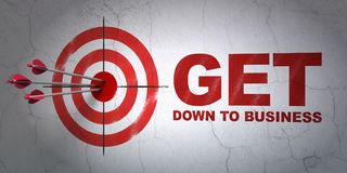 Business concept: target and Get Down to business on wall background. Success business concept: arrows hitting the center of target, Red Get Down to business on Stock Photos