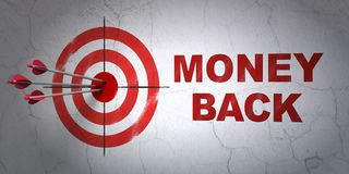 Business concept: target and Money Back on wall background. Success business concept: arrows hitting the center of target, Red Money Back on wall background, 3D Royalty Free Stock Photography