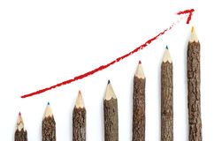 Success business concept. Growing up graph wooden pencils. royalty free stock images