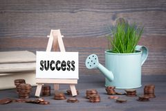 Success, Business Concept. Miniature easel with small change.  Stock Photography