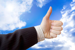 Success in business conceptual image. Businessman hand against the blue sky Stock Images