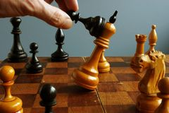 Success in business and confrontation in competition. Pawn wins king. Success in business and confrontation in competition. Black pawn wins king royalty free stock photo