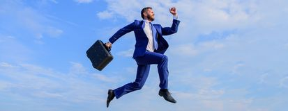 Success in business demands supernatural efforts. Businessman with briefcase jump high in motion forward. Businessman. Formal suit make effort to succeed blue royalty free stock photos
