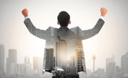 Success business man raise his hand double exposure concept. Of businessman and city royalty free stock photography