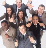 Multicultural business team with thumbs up Stock Image