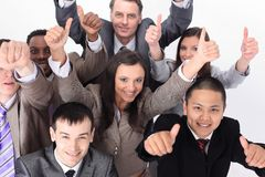 Multicultural business team with thumbs up Royalty Free Stock Image