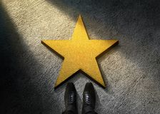 Success in Business or Personal Talent Concept. Top View of Businessman in Shiny Oxford Shoes standing in front of a Golden Star. On the Dark Cement Floor royalty free stock images
