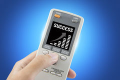 Success business remote controller isolated on blue background, clipping path Royalty Free Stock Photography