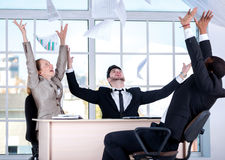 Success in business. Three successful business people sitting in Stock Image