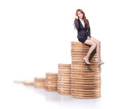 Success business woman sitting on money Royalty Free Stock Images