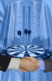 Success in the business world. This blue business related design shows big buildings / skyscrapers, a dart board with the darts in the winning area. On top is a Royalty Free Stock Photo