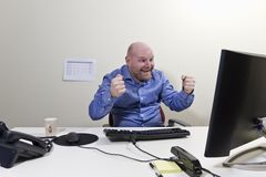Success Businessman. A office worker / businessman expresses success royalty free stock images