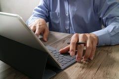 Success businessman hand using stylus pen,digital tablet docking Royalty Free Stock Photo