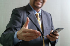 Success businessman open his hand,front view,filter effect Stock Images