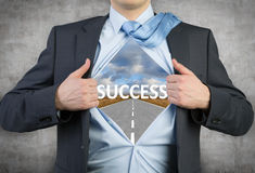 Success. Businessman open his shirt with success on gray background Royalty Free Stock Images