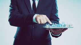 Success businessman using digital tablet show the city skyline Royalty Free Stock Image