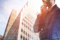 Success and career concept. Portrait of attractive young european businessman standing on abstract city background. Success and career concept. Double exposure Stock Photography