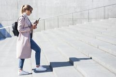 Success and career concept - side view of young woman walking up the stairs stock photos