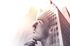 Success and career concept. Thoughtful young businessman on abstract city background. Double exposure Stock Photography