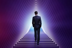 Success and career development concept. Back view of young businessman walking up stairs into infinity. Success and career development concept. 3D Rendering Stock Photography