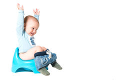 Success on the chamber pot. Happy one year old boy having fun on the chamber pot, isolated over white background stock photography