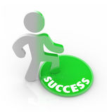 Success Changes a Person - Man Steps on Button. A person stands onto a button marked Success and his color transforms to symbolize his dedication to succeeding Royalty Free Stock Photos