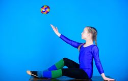 Success. Childhood activity. Acrobatics gym workout of teen girl. Sport and health. Fitness diet. Energy. Gymnastics. Happy child sportsman with ball. Every stock image