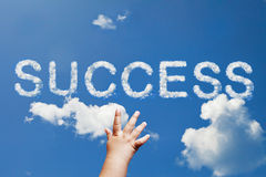 Success cloud. Baby reach the success cloud word on sky Stock Image