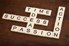 Success components crossword. Success ingredients concept - time, ideas, passion, action crossword with ivory letter blocks on grunge weathered wood Stock Images