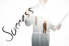 Success concept. Abstract image of thoughtful businesspeople standing on concrete stairs with bright light and text. Success concept. Double exposure Stock Photography