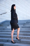 Success concept - beautiful business woman standing on stairs Stock Image
