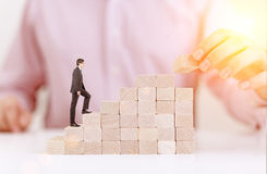 Success concept with block stair. Success concept with businessmen building and walking on wooden block stairs Royalty Free Stock Image