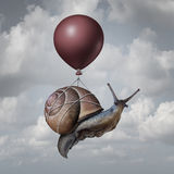 Success Concept. And business advantage idea or game changer symbol as a balloon lifting up a slow generic snail as a new strategy and innovation metaphor for Royalty Free Stock Photo