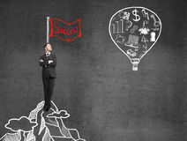 Success concept. Businessman looking on balloon with drawing business symbol. success concept Royalty Free Stock Photos