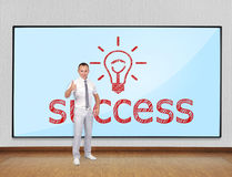 Success concept. Businessman showing thumb up and screen with success Royalty Free Stock Photos