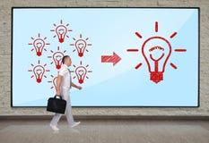 Success concept. Businessmen walking at big plasma panel with success concept Stock Image