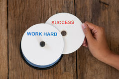 Success concept with compact disk and work hard Royalty Free Stock Photos